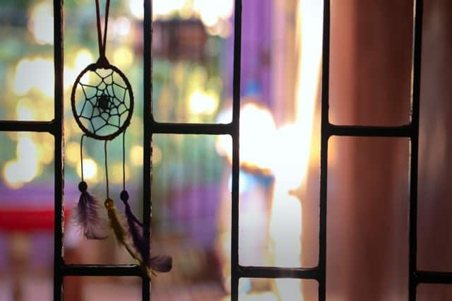 Small dreamcatcher and purple tones are meaningful for someone with traits of intuition,  intuitive person meaning signs you are psychic